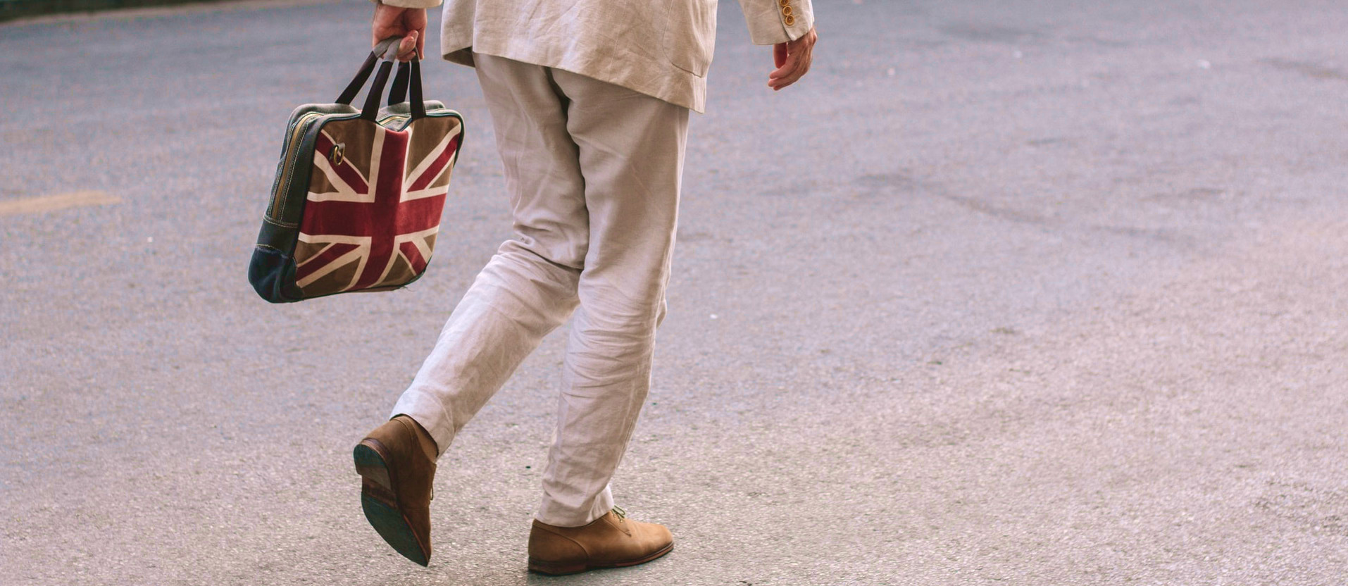 Man holding a bag with the Union Jack on it